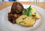Braised lamb shoulder with caponata and news